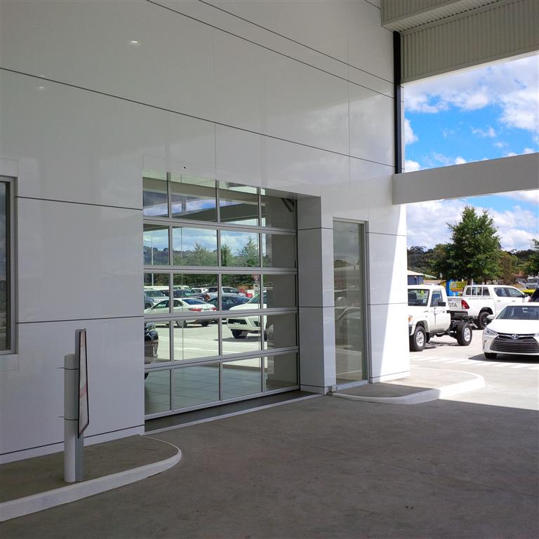 Full vision glass sectional door car showroom